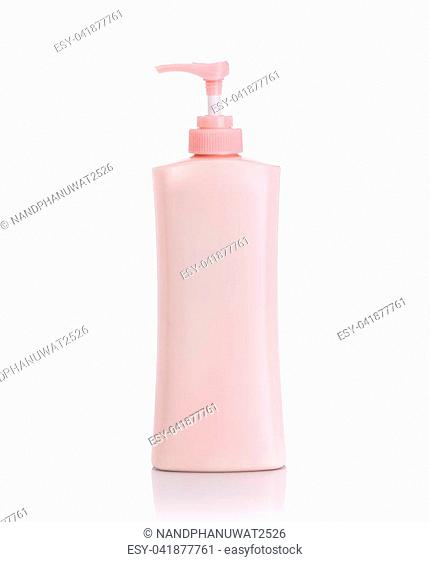 Blank pink pump plastic bottle used for shampoo or soap. Studio shot isolated on white background