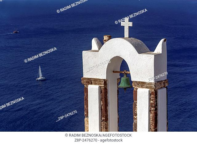 Greek Orthodox Church in Oia village, Tower, Bells, Santorini, Cyclades Islandes, Greece, Europe cat on roof