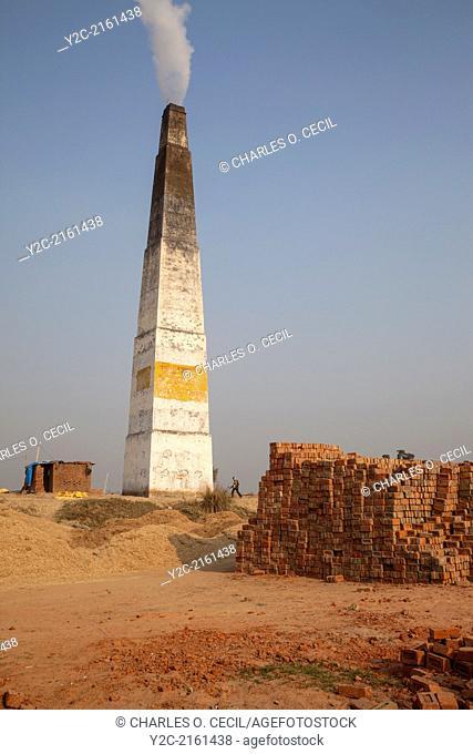 Rajasthan, India. Chimney Emitting Smoke from Underground Ovens Firing Bricks
