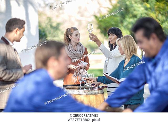Group of sales people and wine workers outdoors
