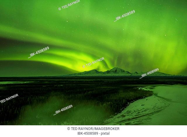 Aurora over the fog shrouded Copper River and mounts Sanford Drum and Wrangell, Wrangell Mountains, Alaska