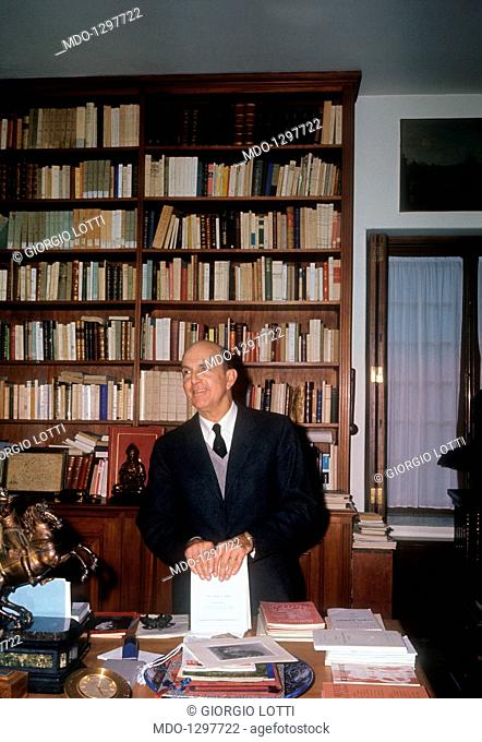 Umberto II in the library of Villa Italia. Umberto II of Italy, smiling behind a desk in his study of Villa Italia. Cascais (Portugal), December 1965