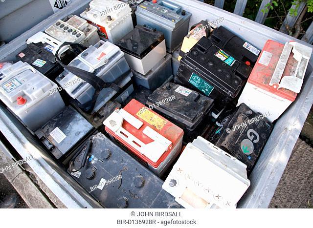 Old car batteries in bin at city tip