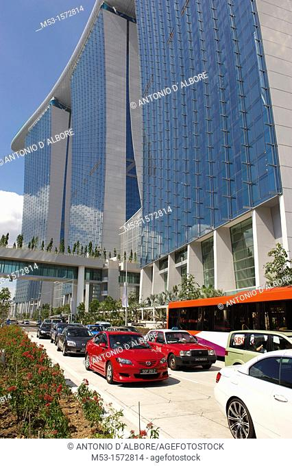 Car and buses along Marina Bay Avenue, with the Marina Bay Sands Hotel on the background  The hotel is part of Marina Bay Sands an integrated resort that...