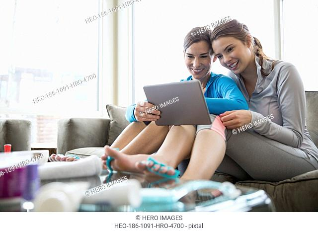 Mother and daughter doing pedicures at home