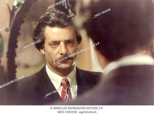 Italian actor and director Giancarlo Giannini looking at himself in a mirror in the film Seven Beauties. Naples, 1975