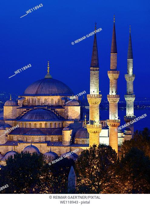 Three minarets of the lit Blue Mosque at dusk on the Bosphorus Sultanahmet Istanbul Turkey