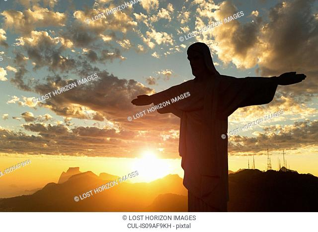 Silhouette at sunset of Christ the Redeemer statue, Rio De Janeiro, Brazil