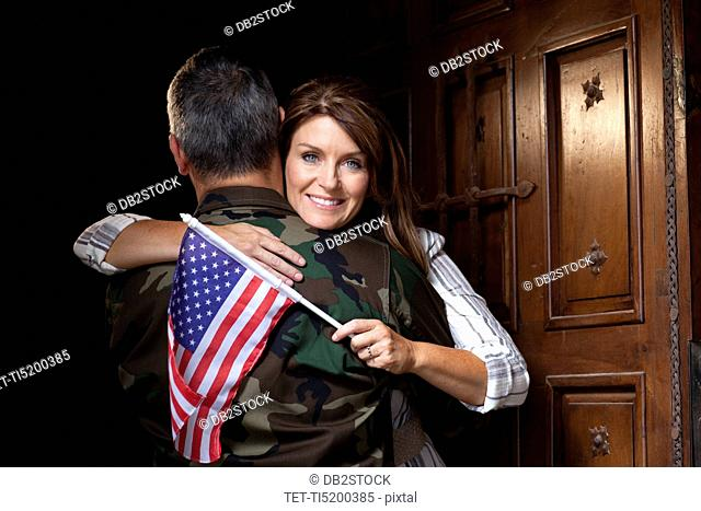 Soldier with wife embracing