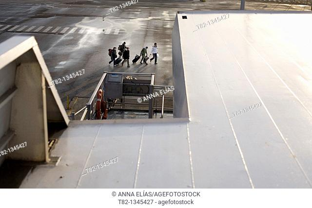 group of passengers with luggage outside the Port of Algeciras, Cadiz, Andalucia, Spain