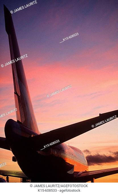 Rear view Boeing 747 against sunset sky