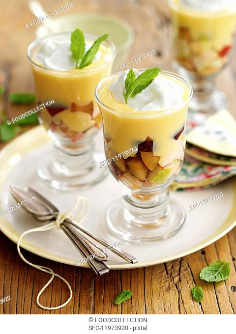 Trifle with fruit, cream and mint