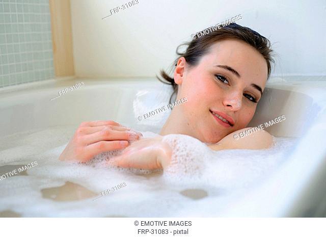 Young woman enjoying bath