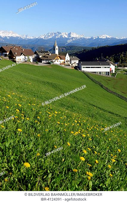 Village of Flaas at the Salten mountain in front of the Dolomites, South Tyrol, Italy
