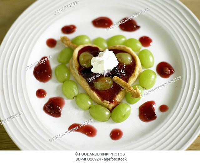 Puff pastry heart with plumb and grape - with recipe / step shot