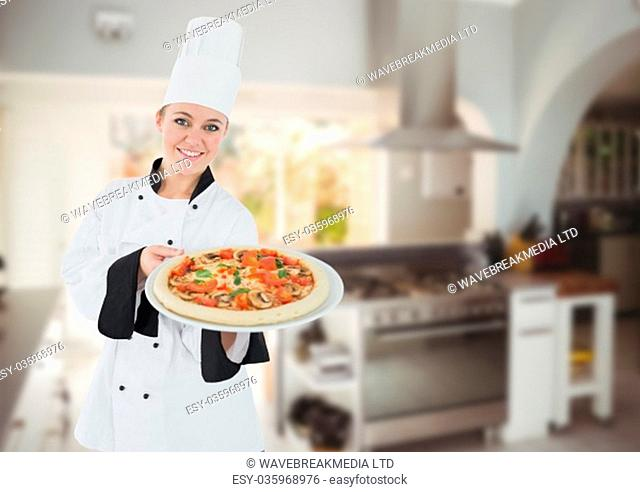 Digital composite of Happy chef showing the pizza in the kitchen