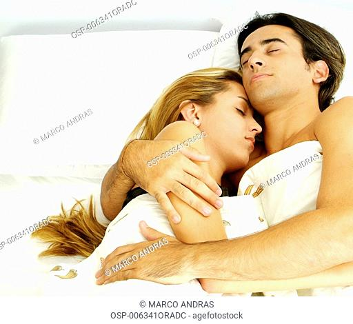 couple sleeping together and hugged
