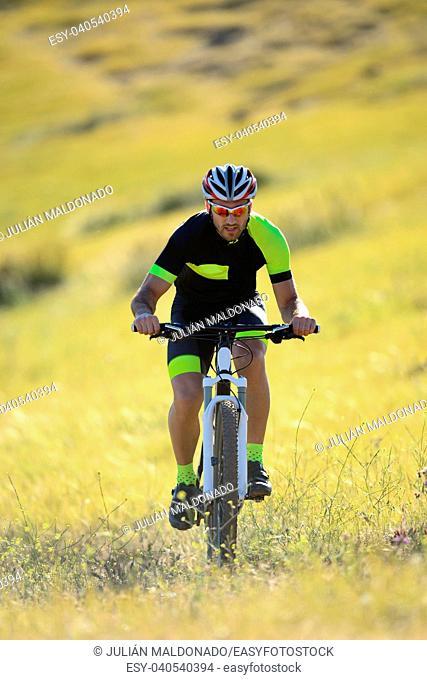 Maontabike cyclist training through the rural environments of Almagro, Ciudad Real, Spain
