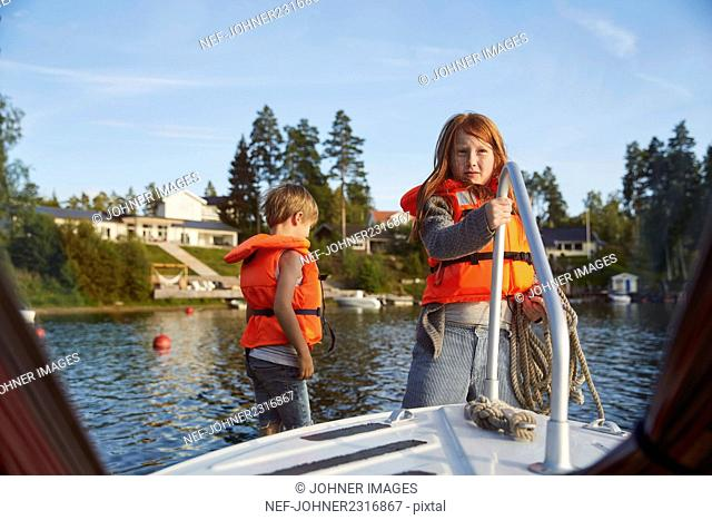 Boy and girl on sailing boat