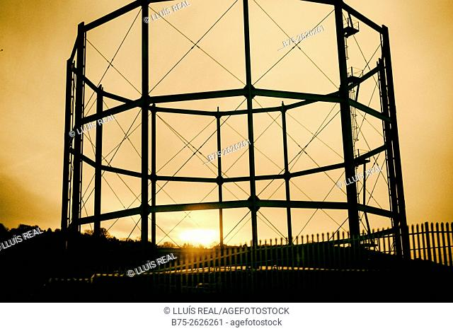 Sunset view of a gas holder. Skipton, Yorkshire, England, UK, Europe