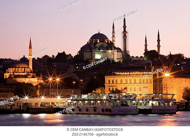 Turkey, Marmara Province, Istanbul, Suleymaniye and Rustem Pasa Mosques in Eminonu with boats in foreground