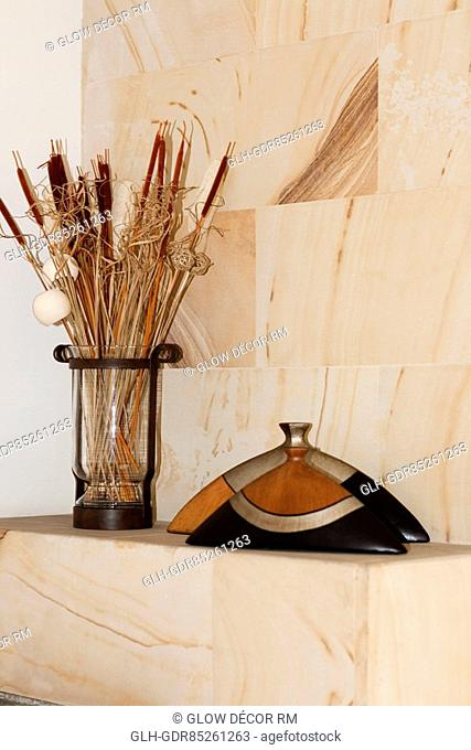Vase with dry reed sticks