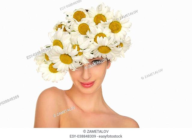 beautiful woman in the hat of daisies isolated on white