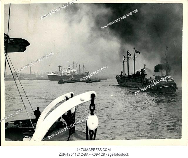 Dec. 12, 1954 - The 'Cutty Sark' on her last journey. Meaning the end.: The famous sailing ship 'cutty sark' was towed from east Indian Deck to her specially...