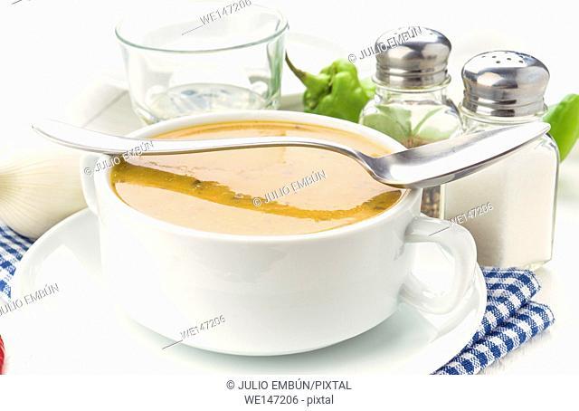 Vegetable cream bowl on white wooden table