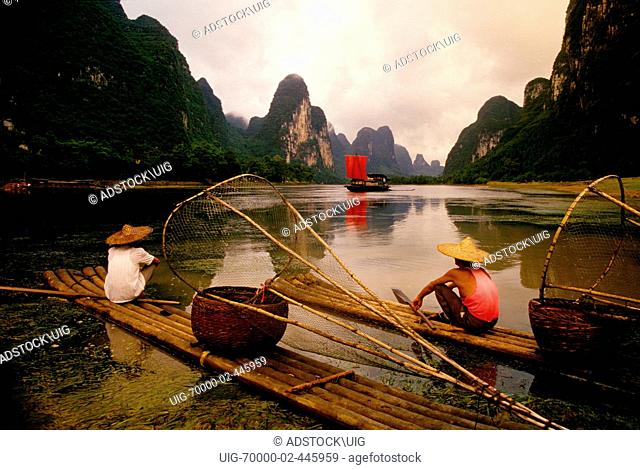 Li River, Guangxi, China: Cormorant fishermen at rest of their bamboo rafts on the river near Xingping Guilin area