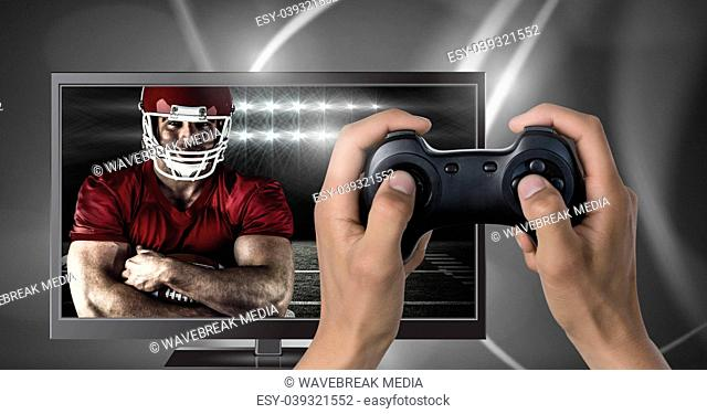 Playing American football computer game with controller in hands