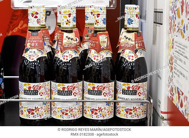 November 15, 2018, Tokyo, Japan - Bottles of Beaujolais Nouveau on sale outside the Bic Camera electronics store in Ginza