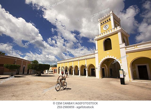 Cyclist in front of the Portales de San Francisco with the clock-tower at the San Francisco Square-Plazuela De San Francisco, Campeche, Campeche State, Mexico