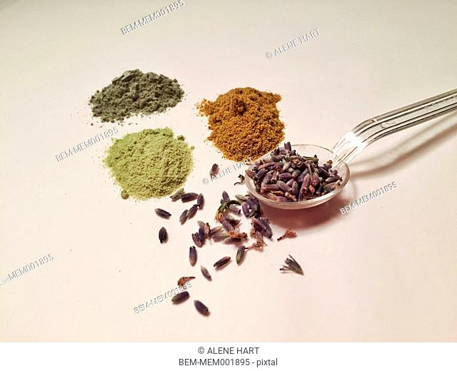 Ground powders, spices and lavender with spoon