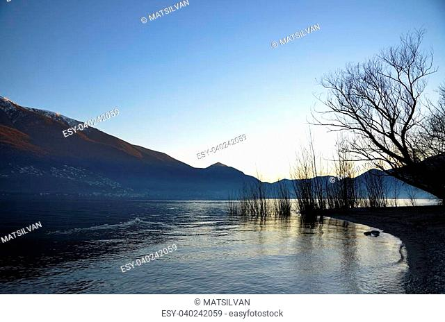 Sunset over an alpine lake with mountains
