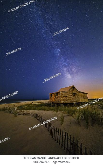 Jersey Shore Setting Moon and Milky Way - Island Beach State Park at the NJ Shore with beach fences leading to the Judge's Shack underneath a starry sky with...