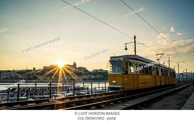 Tram at sunset along the Danube, Hungary, Budapest