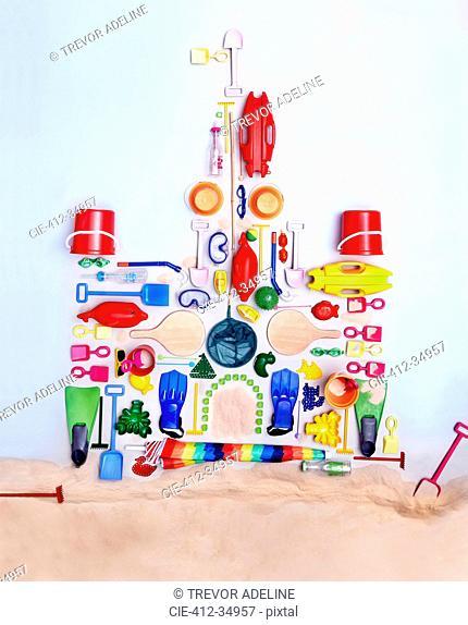 Still life concept beach toys forming sand castle
