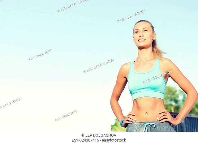 fitness, sport, friendship and healthy lifestyle concept - happy young woman exercising outside