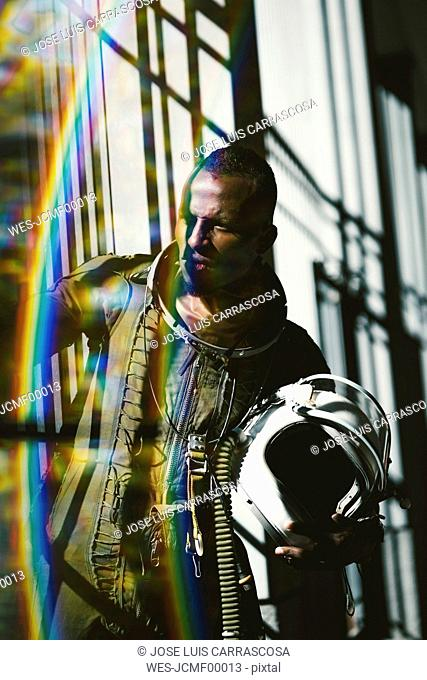 Portrait of serious astronaut in spacesuit