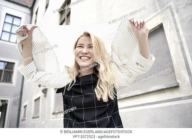 stylish Asian woman in city Munich, Germany