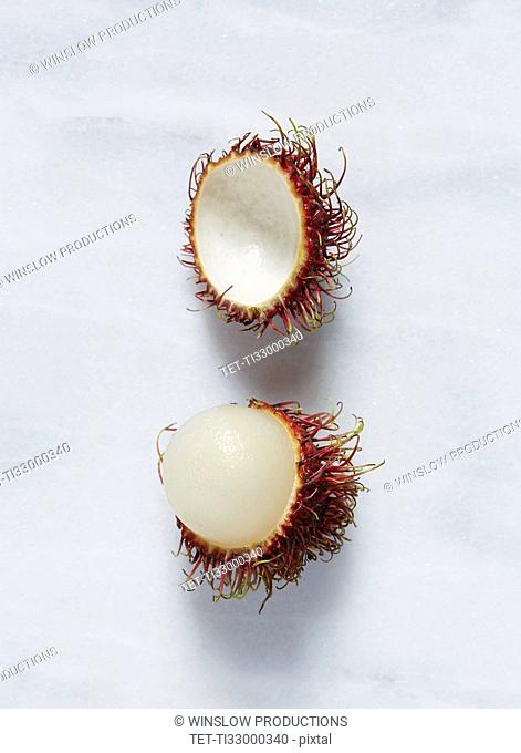 Rambutan (Nephelium lappaceum) fruit against white background