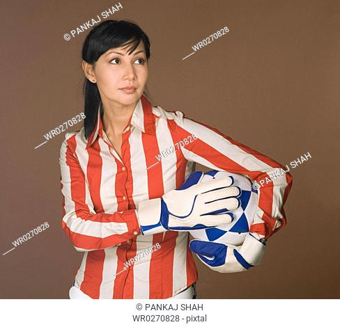 Young woman holding a football