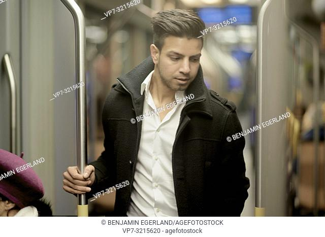 Young man in public transport. Munich, Germany