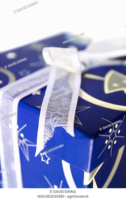 A stock photograph of a bright blue gift box