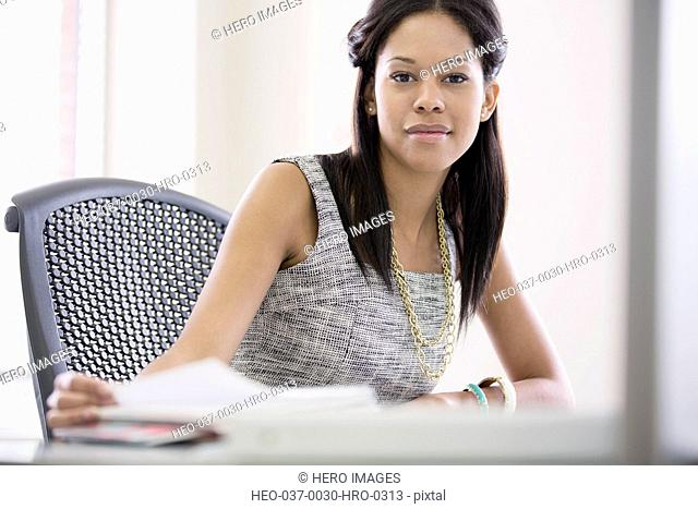 pretty, mid-adult businesswoman at desk