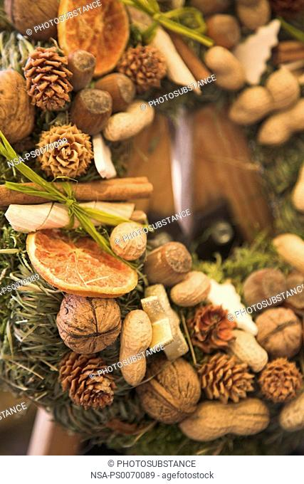 Close up of pine cones and dry fruits decorated during Christmas