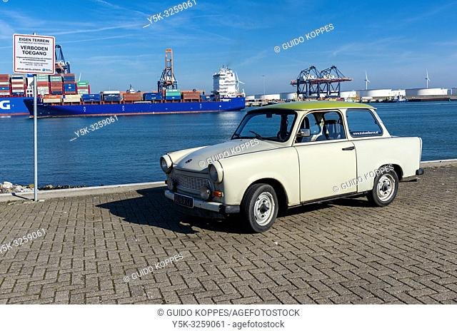 Rotterdam, Netherlands. A Deutsche Democratische Republik build, vintage Trabant (1971) driving around the Port of Rotterdam Harbor area on a sunny