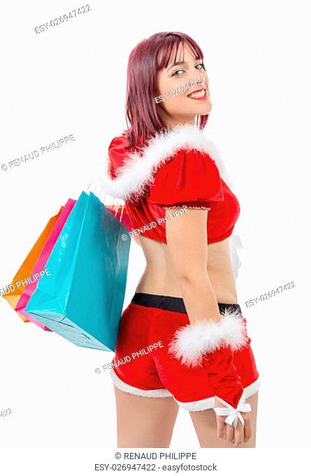 a beautiful Santa Claus woman holding shopping bags