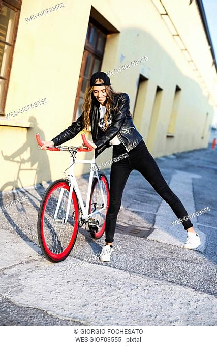 Fashionable young woman with bicycle